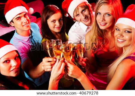 Above angle of young people enjoying themselves at Christmas party - stock photo