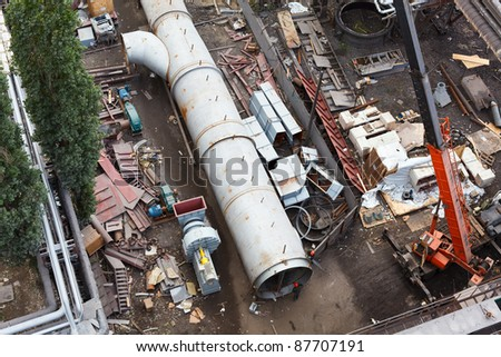 Above-ground gas, oil and heat pipes rack in factory area. Aerial view