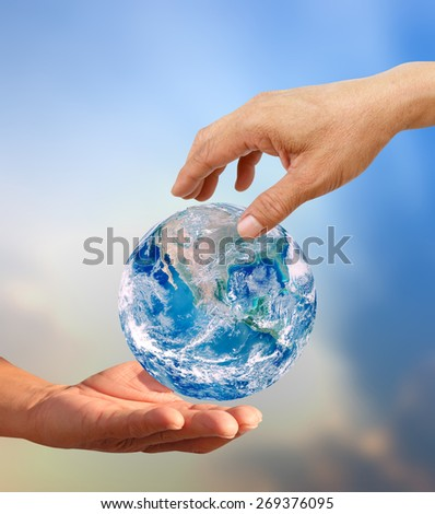 Above human hand giving global Earth to below hand a Think Earth Concept Elements of this image furnished by NASA - stock photo