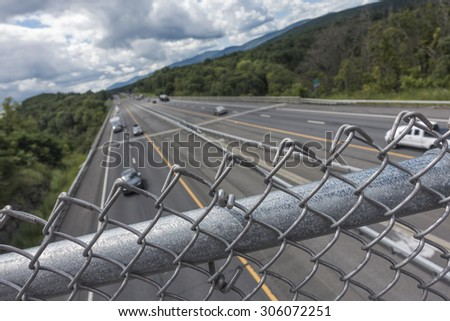 above interstate highway with fence - stock photo