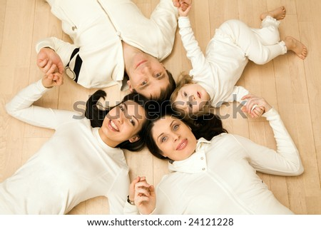 Above shot of Caucasian family consisting of father, mother, teenage and younger daughters - stock photo