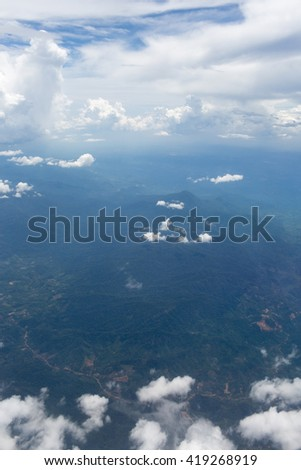 Above the clouds.Aerial cloudscape sky in stratosphere shot from airplane window - stock photo
