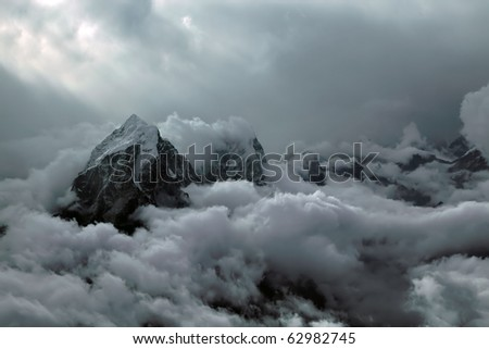 Above the clouds in Himalaya while climbing - stock photo