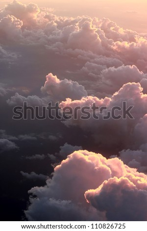 Above The Clouds Photo of puffy clouds. - stock photo