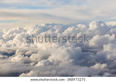 Above the clouds, view from airplane window - stock photo