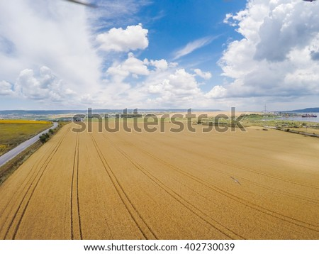 Above the field, aerial view - stock photo