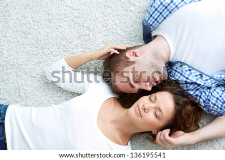 Above-view image of a happy couple enjoying togetherness - stock photo