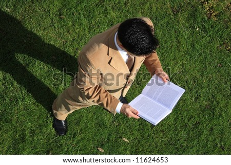 Above view of a business man reading a book