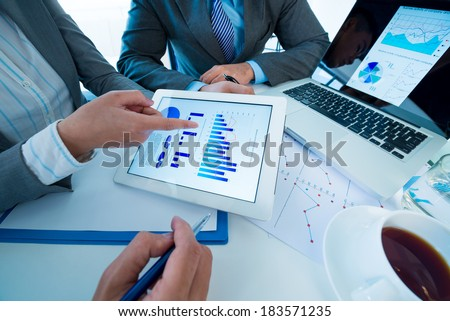 Above view of a business team discussing business strategy at the workplace  - stock photo