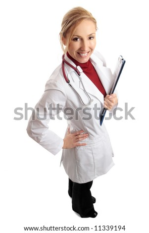 Above view of a smiling bright confident female doctor (or nurse) standing and holding folder of medical paperwork. - stock photo