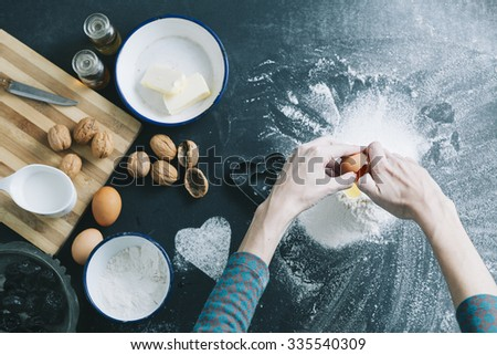 above view of a table with cookie cutter flour and various ingredients - stock photo