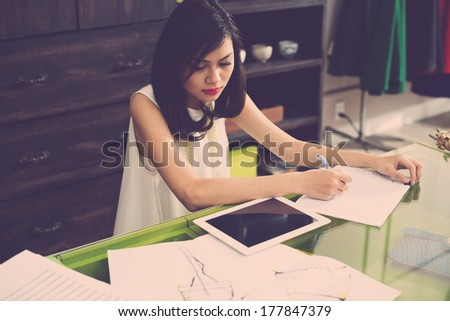 Above view of a young modern wed designer at work  - stock photo
