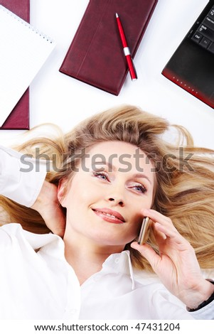 Above view of beautiful businesswoman calling by mobile - stock photo