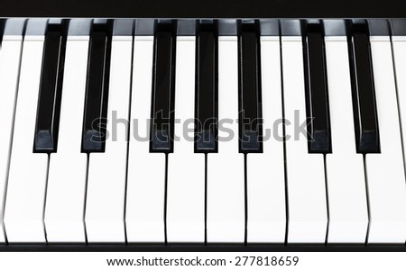 above view of black and white keyboard of digital piano close up - stock photo