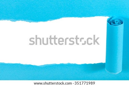 above view of blue rolled-up torn paper isolated on white background - stock photo