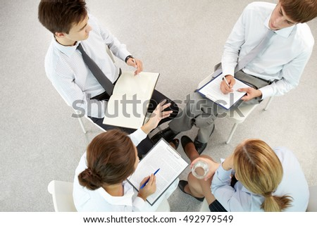 Above view of business colleagues discussing during a meeting