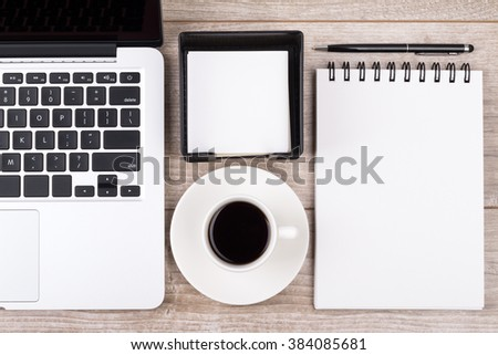 Above view of business man working place. Cup of coffee, laptop, notebook and pen. Business, education or blogging concept. - stock photo
