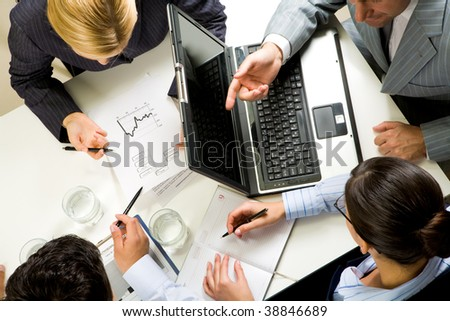 Above view of business people communicating at work - stock photo