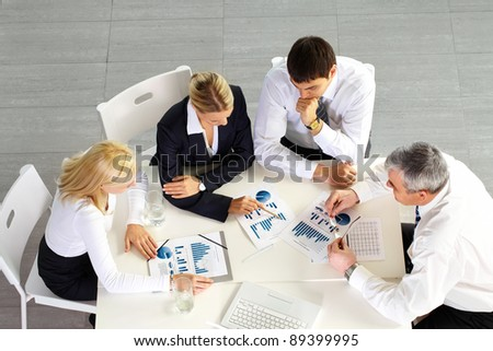 Above view of business team discussing future strategy - stock photo
