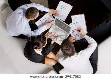 Above view of business workteam thinking about new project at meeting - stock photo