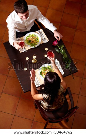 Above view of couple celebrating Valentine?s Day in the restaurant - stock photo