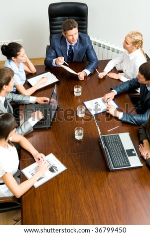 Above view of friendly team planning work at meeting - stock photo