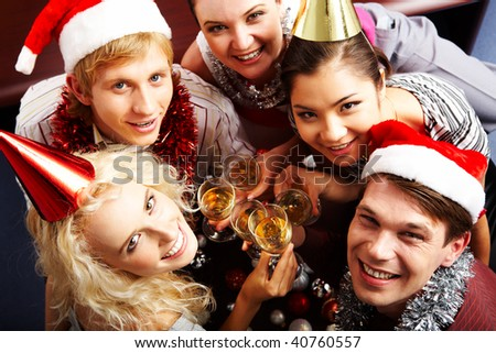 Above view of glad people looking at camera and laughing at party - stock photo