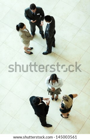 above view of group of business people having informal meeting - stock photo