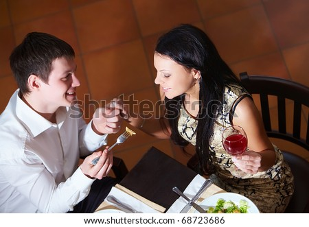 Above view of happy couple eating at dinner - stock photo