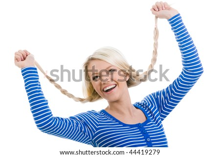 Above view of happy girl with raised arms holding her pigtails over white background