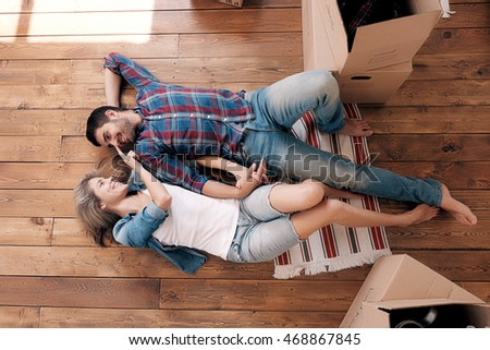 Above view of happy young couple looking at each other in new house