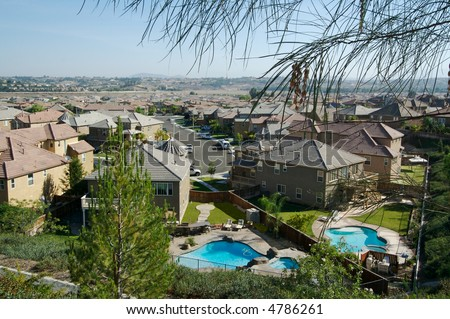 Above View of New Contemporary Neighborhood with Pools - stock photo