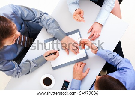 Above view of people discussing new ideas in the office - stock photo