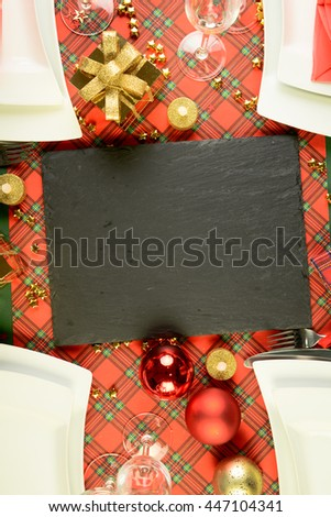 above view of red and golden christmas table decoration with copy space - stock photo