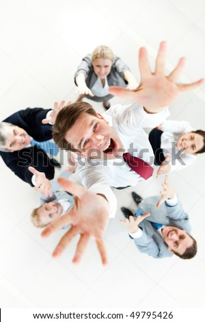 Above view of several successful partners throwing new ceo upwards - stock photo