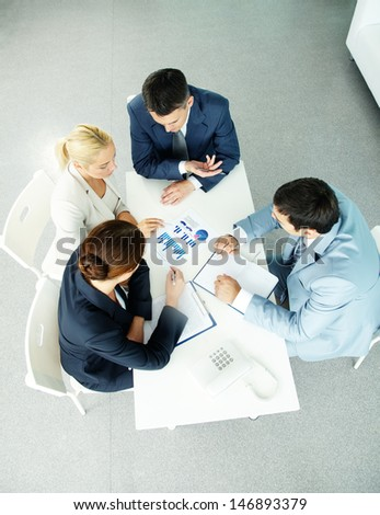 Above view of successful partners during negotiations at meeting