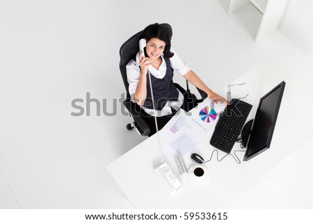 above view of young businesswoman working in office - stock photo