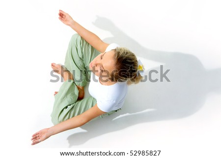 Above view of young woman meditating in pose of lotus - stock photo