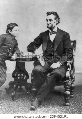 Abraham Lincoln (1809-1856) and his son Thaddeus (also called Thomas and Tad). This Alexander Gardner portrait of Feb. 5, 1865 was Lincoln's last photography sitting. - stock photo