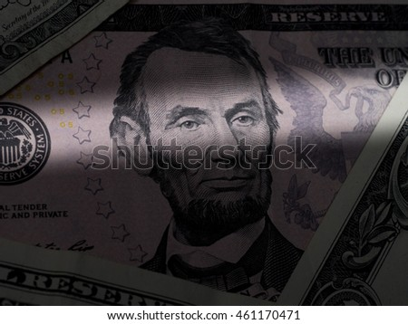 Abraham Lincoln eye close up from 5 dollar bill