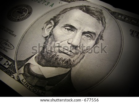 Abraham Lincoln from the front of a $5 bill. - stock photo