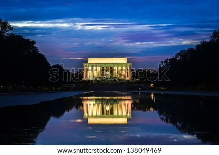 Abraham Lincoln Memorial and mirror reflection on water at night - Washington DC, United States  - stock photo