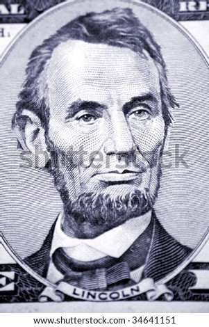 Abraham Lincoln on five dollar banknote - stock photo