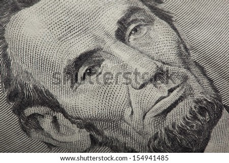 Abraham Lincoln portrait from five dollars bill - stock photo