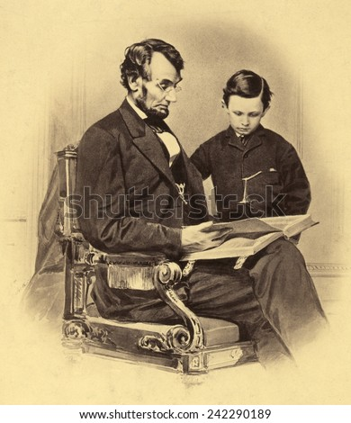 Abraham Lincoln reading the Bible to his son Tad, in 1865. Thomas 'Tad' Lincoln, the Lincoln's fourth child, was born on April 4, 1853 and died young, in 1871 of tuberculosis.