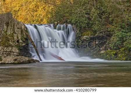 Abrams Falls At Cades Cove In The Great Smoky Mountain National Park taken with a slow shutter speed to blur the water motion - stock photo