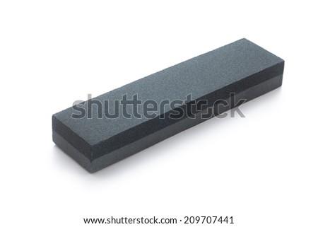abrasive whetstone on white background - stock photo
