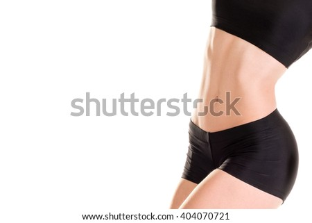 Abs of slim, muscular women isolated on white - stock photo