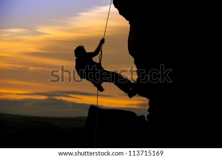 abseil silhouette of man against the sunset