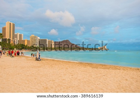 Absolutely amazing orange sunset view on the Honolulu city from the Waikiki beach with a Diamond head crater on the background. - stock photo